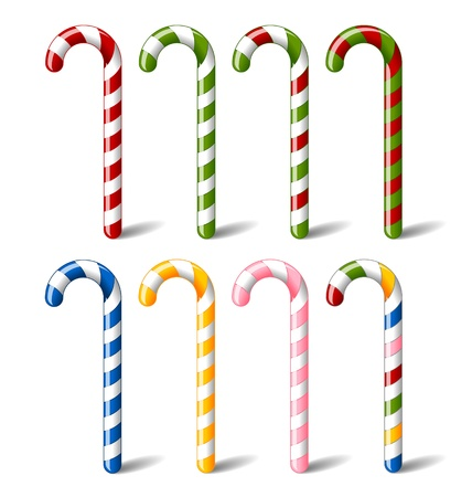 canne a sucre: Color�, des cannes de bonbon ray� isol� sur fond blanc
