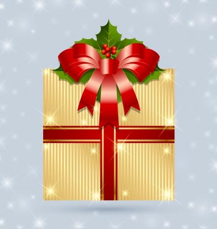 Kerst cadeau met lint en hulst verpakt in gouden folie