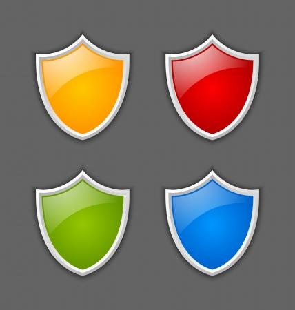 Four colorful glossy shields on dark grey background