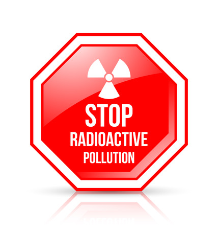 Red and white STOP RADIOACTIVE POLLUTION sign with nuclear symbol on background