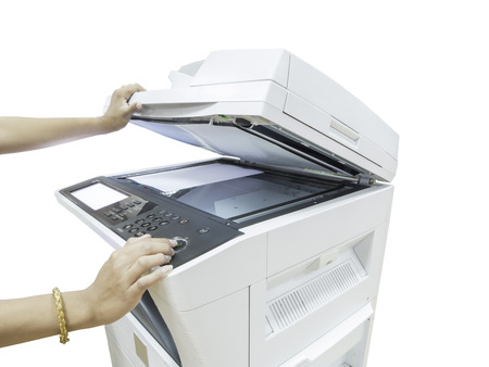 A person handling a multi purpose copier machine isolated on white background photo