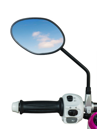 Handle and mirror  with reflected blue sky of motorcycle