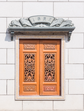 Chinese Traditional wood carvings window and cement eaves.