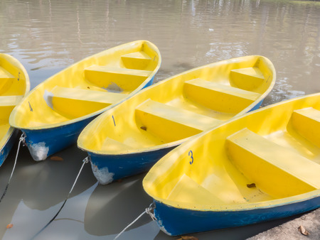 fiberglass: Fiberglass Rowing Boats On Water