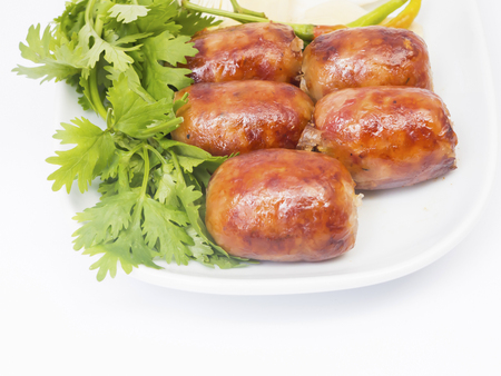 Thai sausage on white dish with chilli and vegetable photo