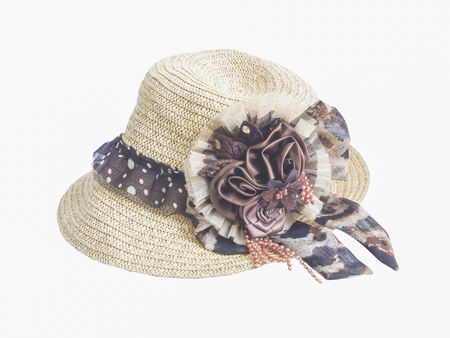 straw hat with artificial flower on white background photo