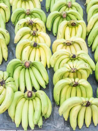 sappy: Bunch of bananas on the floor in the market