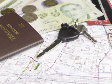 Key car with mobile phone and passport on map for traveling necessary things concept photo