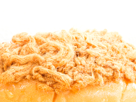 Close up bread with dried shredded pork on white background photo