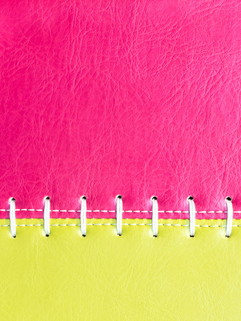 Pink and yellow  leather with white stitch close up photo