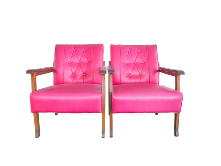 Twin pink old sofa chair isolated on white background photo