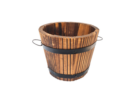 wooden barrel or bucket isolated on white background photo