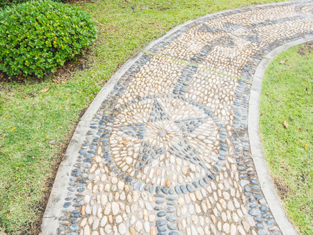star path: Stone path with star shape on green grass