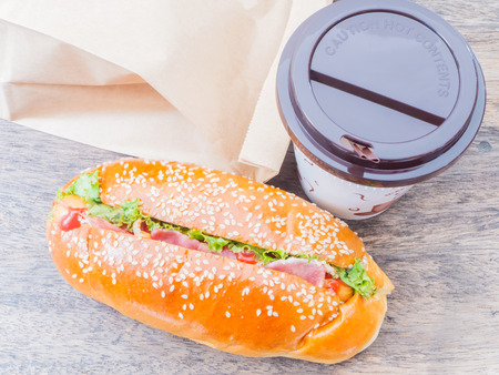 Take away cup of coffee and hot dog with paper bag Stock Photo