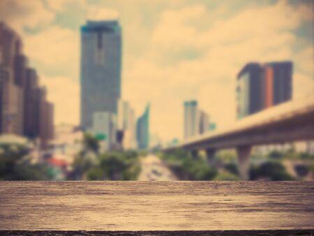 wooden floor over blur city abstract background, vintage filter effect Standard-Bild