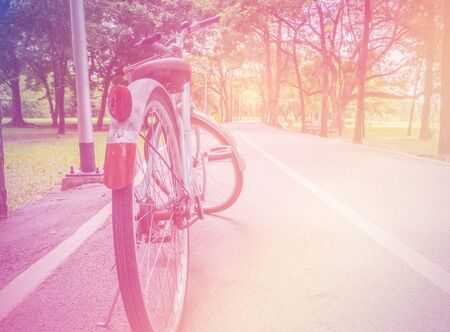 soft pedal: bicycle parking in the park , soft focus with vintage color tone Stock Photo