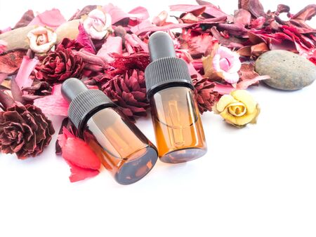 potpourri: Dropper bottle with red potpourri dried flower for spa Background