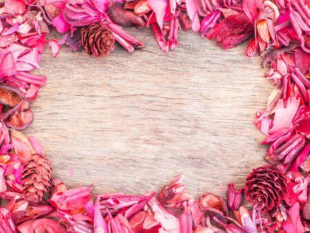 potpourri: red potpourri frame on wooden floor for spa Background