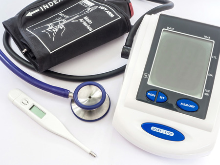 Digital Blood Pressure Monitor, stethoscope and thermometer on white background, primary healthy check