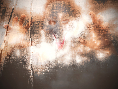 misted: Devil behind the  misted glass window for halloween background