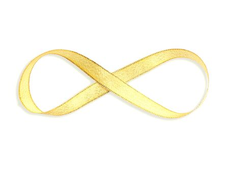 Above view of gold satin ribbon with infinity shape, isolated on white background