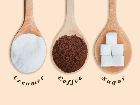 creamer: Coffee powder and creamer with sugar cubes on wooden spoon