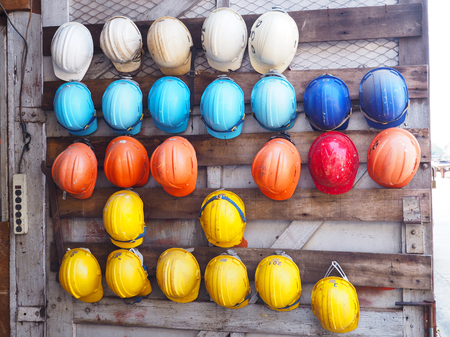 old colorful construction helmets