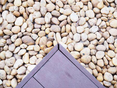 on wood floor: wood floor tile over round stone background