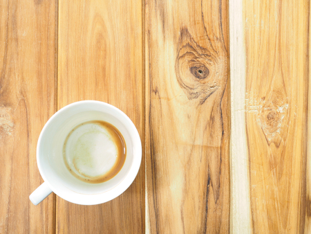 stimulating: Empty coffee cup after drink on wood table