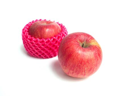 cushioning: Red apples wrapped by foam net protection