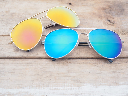 mirrored: Fashionable mirror sunglasses on wooden background