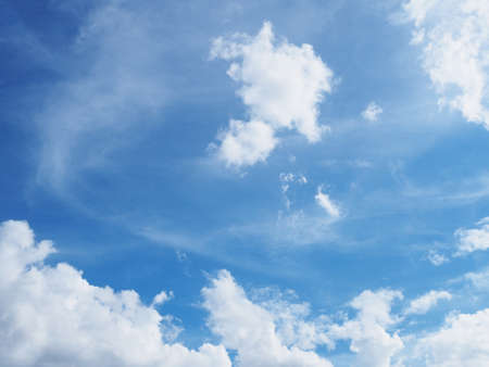 gloom: Clear blue sky background with white clouds