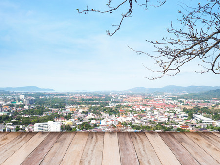 phuket province: Wooden floor over aerial view  of cityscape Phuket province, Thailand.