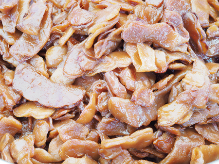 Close up pile of pickled tamarinds, top view.