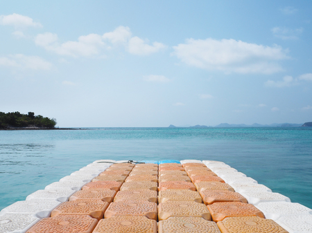 plastic floating pier on sea at summer beach Stock Photo