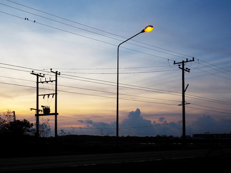 wire: Silhouette of electric poles  and cables over sunrise sky background. Energy and technology concept.