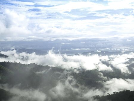 foggy hill: Fog and clouds above the mountains as wave in rainy season at Thailand. Stock Photo