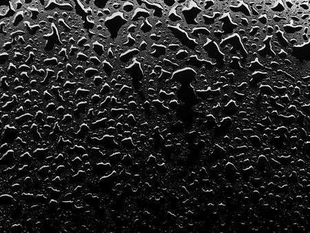Close up water drops on black surface background Stock Photo