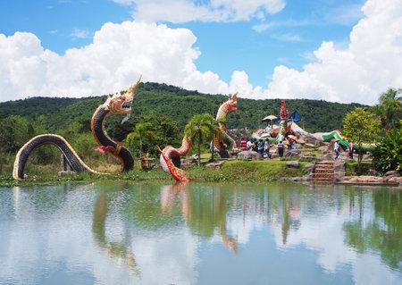 BANGKOK , THAILAND - OCTOBER 08, 2017: King of Naga statues group in the pond over mountain and blue sky background at Buddha Uttayarn Luang Phu Sod in Ban Na Dam, Prachin Buri province, Thailand.