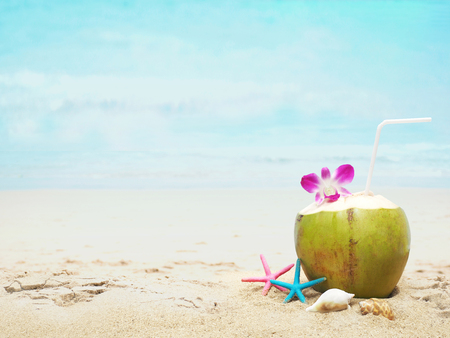 a48f401740e Summer beach background. Coconut drink and starfishes on summer beach with  copy space.