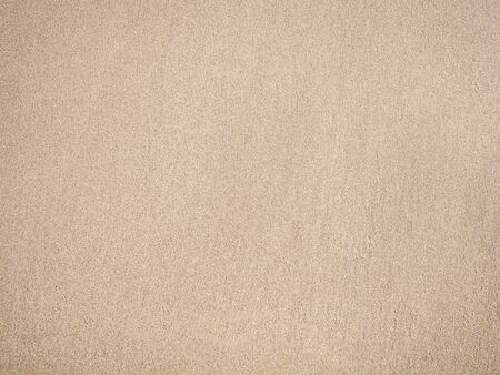 Sand texture beige color for summer beach background. 写真素材