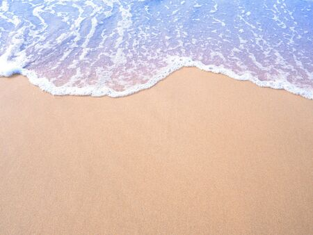 Beige sand and pastel water wave vintage filter effect. Summer beach on holiday vacation concept background.