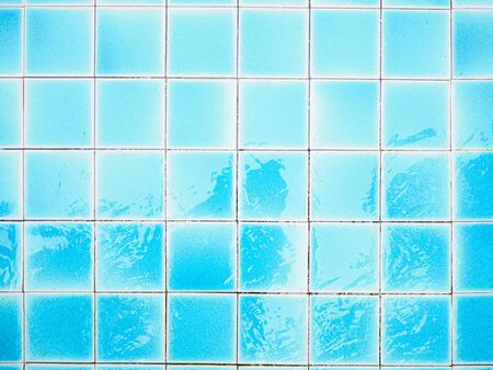 Close up blue floor tiles at the bottom swimming pool.