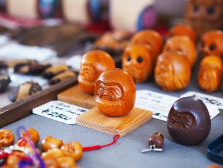 TAKAYAMA, JAPAN: NOVEMBER 21, 2018: The owl souvenir wooden craft toy display to sell at Takayama Morning Markets (Asaichi) in Japan.