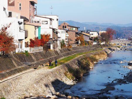 Landscape of Takayama city and  Miyagawa river with bridges in Japan autumn.