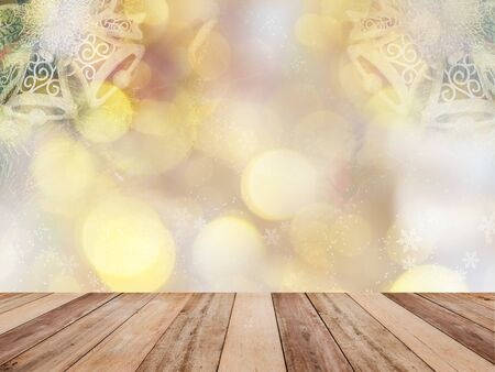 Wooden table top over abstract Christmas background with  ornament decoration and golden bokeh. Montage style to display the product. Zdjęcie Seryjne