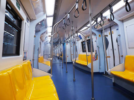 Bangkok, Thailand - January 09, 2020 : BTS Sky train interior perspective view with empty seats in the early morning.