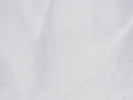 Close up surface white linen fabric of bed sheet. Standard-Bild
