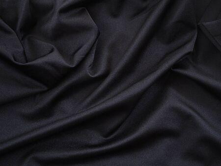 Smooth black silk or satin luxury texture for wedding background.