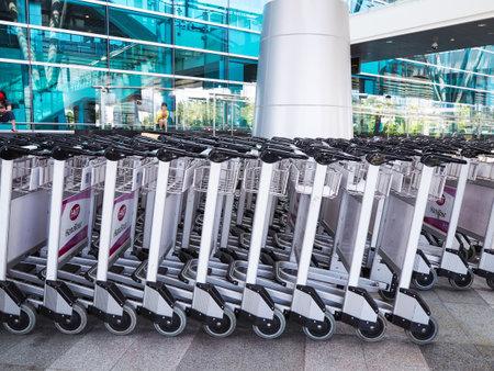 DANANG, VIETNAM - APRIL 03, 2019: Row of luggage carts at the terminal of Danang International Airport.